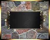 The texture of the stone in a gold frame with a gold name plate — Stock Photo