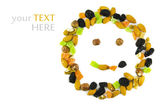 Nuts and dried fruit in the form of a smile, of isolation on a white background — Stock Photo