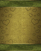 Drawing hearts on a green background, with a golden nameplate — Stock Photo
