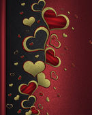 Zlaté srdce na pozadí černo červená — Stock fotografie