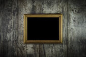 Old frame on grunge old wooden background — Stock Photo