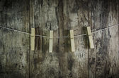 Clothes-peg for linen with rope on retro old wooden background — Stock Photo