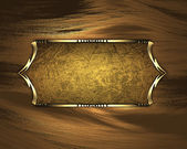 Black nameplate with gold ornate edges, on golden background — Stock Photo