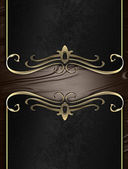 Black nameplate with gold ornate edges, on brown background — Stock Photo