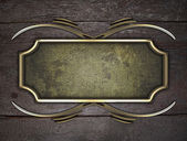 Wooden texture with gold name plate with gold ornate edges — Stock Photo
