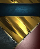 Gold rich texture with black and brown corners, and blue nameplate — Stock Photo