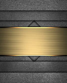 Metal texture with different notches and gold nameplate — Stock Photo