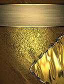 Gold texture with gold inserts and gold nameplate — Stock Photo