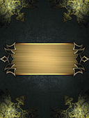 Black texture with worn gold corners and gold nameplate — Stock Photo