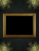 Black texture with worn gold corners and wooden frame — Stock Photo