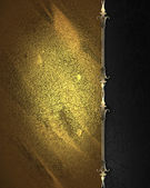 Black plate with gold ornate edges, on gold background. — Stock Photo