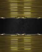 Gold texture, with black nameplate and gold trim — Stock Photo