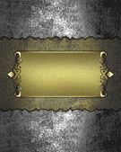 Template for design. Grunge iron texture with gold nameplate — Stock Photo