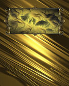 Beautiful gold background, with abstract gold plate with gold trim — Stock Photo
