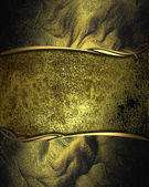 Rich dark gold background with a beautiful plate and gold trim — 图库照片