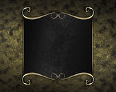 Gold background with Black nameplate with gold trim — Stock fotografie
