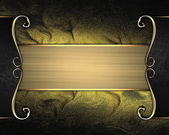 Rich dark gold background with a beautiful plate and gold trim — Stock fotografie