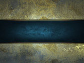 Old dark yellow background with blue plate — Stock Photo