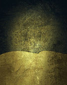 Dark gold background with a sign from scratched gold — Stock Photo