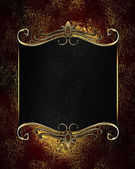 Red-golden background with black nameplate with gold ornament — Photo