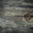 Wedding rings on a dark wooden background. — Stock Photo #38694839