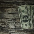 Stock Photo: Close-up of $100 banknotes on wooden background