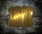 Old wood texture with gold nameplate — Stok fotoğraf