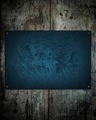 Vintage holz hintergrund mit blauen platte — Stockfoto