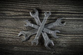 Set of wrenches on wooden background — Stock Photo