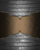 Metal background with brown plate with gold trim — Stock Photo
