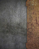 Rusty metal plate on a wall. Design template. — Stock Photo