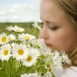 Beautiful girl with daisies, summer fun concept — Stock Photo #38788865