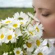 Beautiful girl with daisies, summer fun concept — Stock Photo #38788867