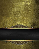 Gold rich texture with black ribbon and gold pattern on the edges — Stock Photo