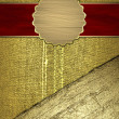 Gold fabric texture with golden grunge edgeand red ribbons — Stock Photo #39023127