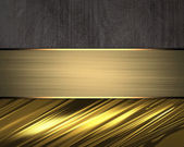 Brown background with gold accents and gold plate — Stock Photo