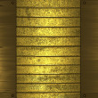 Background of gold stripes with gold plates on edges. Design template — Stock Photo #42706059