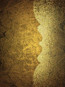 Gold grunge background with a frayed edge — Stock Photo