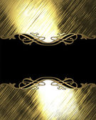 Shiny gold background with black plate with gold trim — Stock Photo