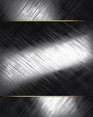 Old scratched metal texture with metal nameplate — Stock Photo