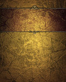 Grunge gold background with red gold plate — Stock Photo