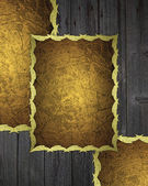Golden plate with gold trim on wood background. — Stock Photo