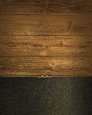 Grunge trä bakgrund med svarta namnskylten med guld trim. formgivningsmall. mall för webbplats — Stockfoto