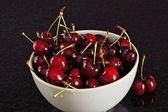 Red cherries in bowl — Stock Photo
