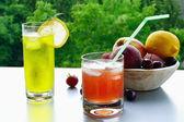Ice-cold fruit lemonade in glasses — Stock Photo