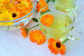 Marigold tea and flowers — Stock Photo