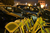 Parked hire bikes - night shot — Stock Photo
