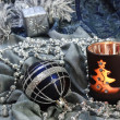 Christmas background with ornaments and candle — Stock Photo