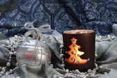 Silver Christmas ball and candle — Stock Photo