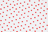 Red heart pattern on white background — Stock Photo